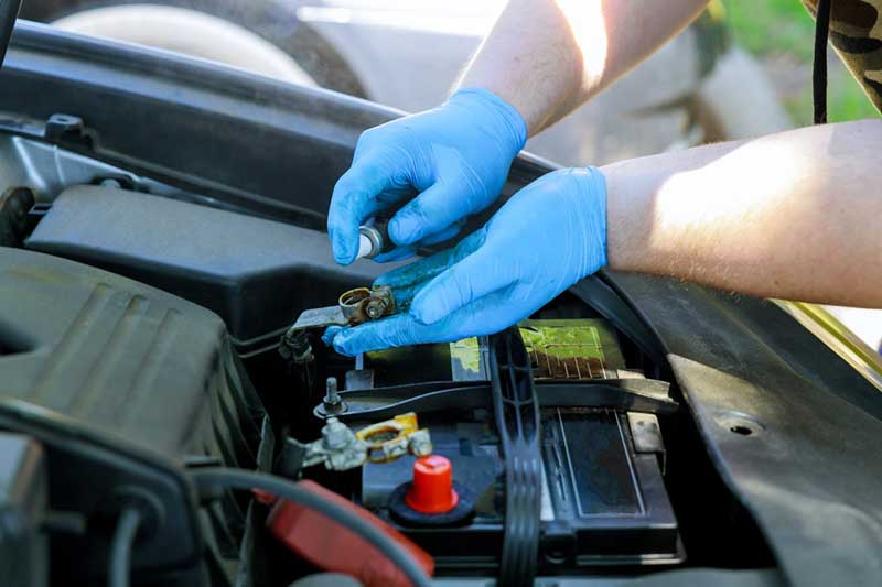 mechanic in fort collins cleaning car battery terminals