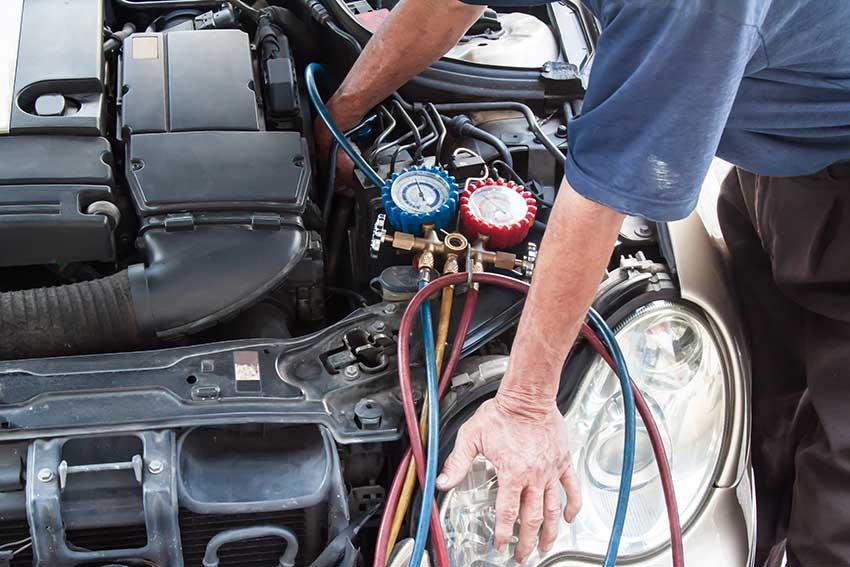 mechanic performing ac repair
