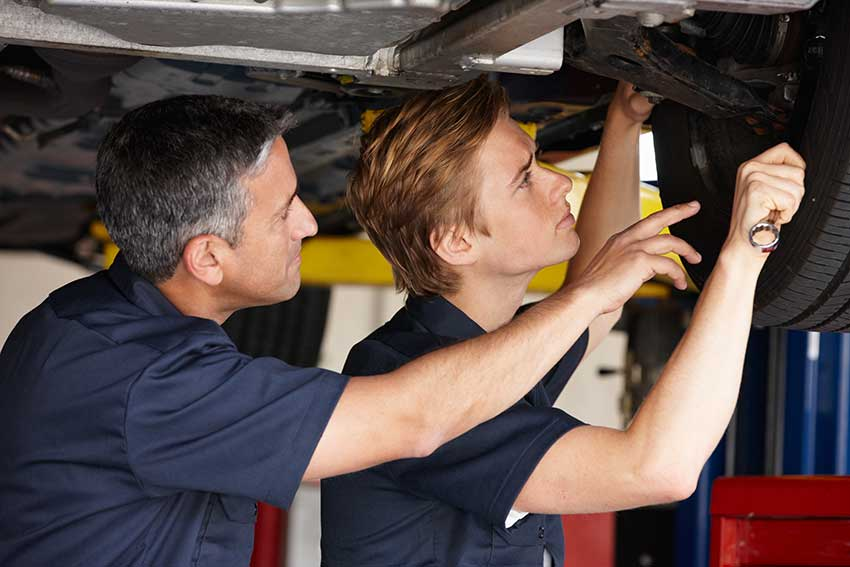 mechanics performing auto repair in fort collins