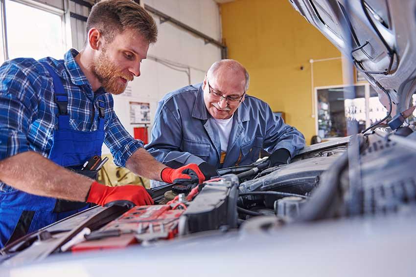 mechanics discussing auto repair