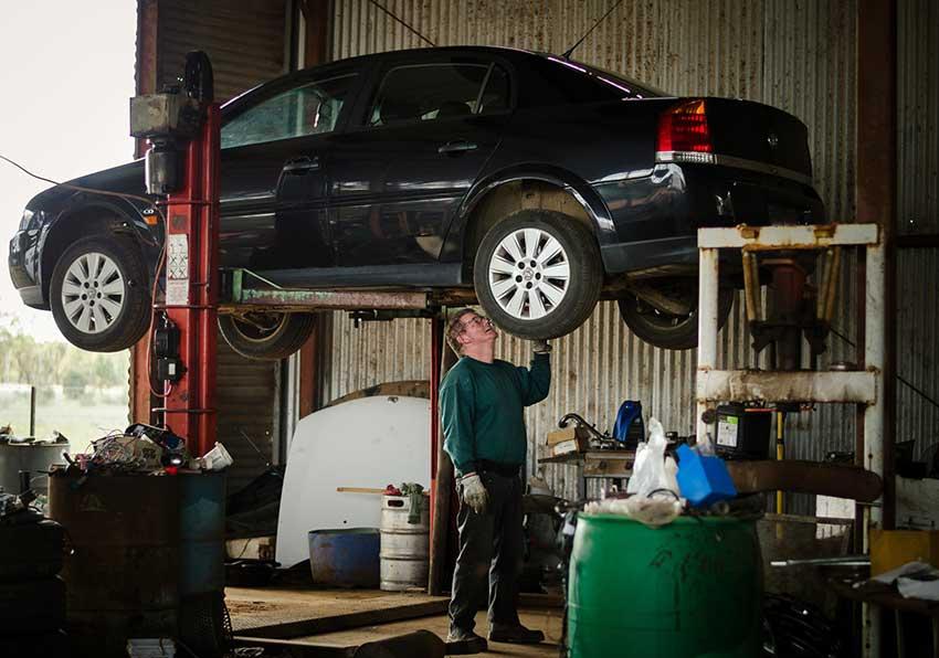 mechanic investigating car
